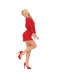Dancing lovely woman in red dress Royalty Free Stock Photo