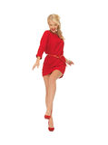 Dancing lovely woman in red dress Stock Image