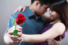 Dancing Lovers. Dancing romantic lovers with a rose in hand.Narrow depth of field Royalty Free Stock Image
