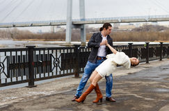 The dancing loving couple on the embankment royalty free stock photography