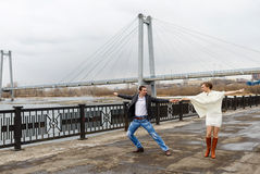 The dancing loving couple on the embankment Royalty Free Stock Photo
