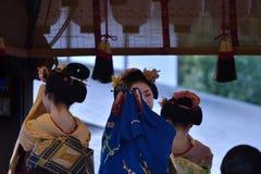 Maiko girls dancing, Kyoto Japan. Dancing Maiko girls in beautiful Kimono dress at the stage of Yasaka shrine in winter, Kyoto Japan Royalty Free Stock Photography