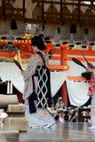 Dancing Maiko woman at Japanese Shrine, Kyoto stock photos
