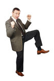 Dancing man in business suit. Isolated on white background Royalty Free Stock Photos