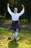 Dancing man in scottish costume with sword Royalty Free Stock Images