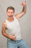 Dancing Man in Undershirt. Dancing Caucasian man in blue jeans and undershirt Royalty Free Stock Photo