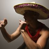 Dancing man wearing sombrero. Stock Photos