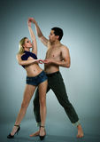 Dancing man and woman Stock Images