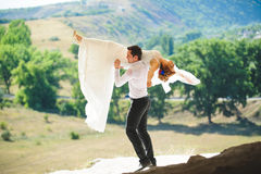 Dancing Man and Woman. Man holding women on shoulder at dance Stock Photography