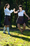 Dancing man and woman in scottish costume Royalty Free Stock Photo