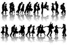 Dancing man and women Stock Photos