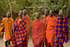 Dancing Masai men. KENYA-2008,JULY 13. : Group of dancing and singingadult Masai men in native Masai village nearby Ololaimutiek Gate to NR Masai Mara,western Stock Photo