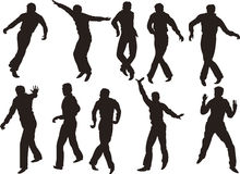 Dancing men. Silhouettes of men dancing  rock'n'roll Stock Image