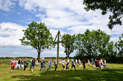 Dancing at midsummer in Sweden. Traditional swedish dancing at Midsummer Day on June 23, 2012, around a midsummer tree to celebrate the summer Stock Image