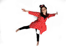 Dancing Minnie Mouse. Dancing young teenager girl dressed like Minnie Mouse stock photo