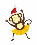 Dancing monkey in a Santa hat. Dancing and smiling  monkeys  in a Santa hat and yellow skirt Royalty Free Stock Photos