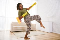 Dancing with mop. Happy woman dancing with mop in hands stock images