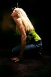 Dancing motion. Woman dancing, studio dark background, motion royalty free stock images