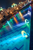 Dancing Multi Colored fountain at night Royalty Free Stock Images