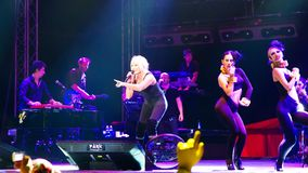 Dancing and the music. ISTANBUL - SEPTEMBER 18: Pop star Ajda Pekkan performs live during a concert at Maltepe on September 18, 2011 in Istanbul, Turkey Stock Image