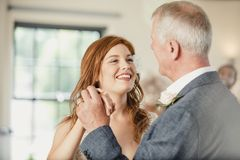 Dancing with my Father at my Wedding. Beautiful bride is enjoying a dance with her father on her wedding day Royalty Free Stock Image