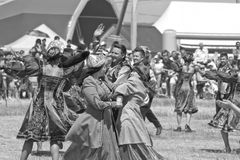 Dancing in national costumes at the celebration of Sabantuy Stock Photo
