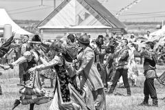 Dancing in national costumes at the celebration of Sabantuy Royalty Free Stock Photo