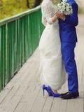 Dancing Newlyweds on Bridge Stock Photos