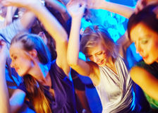 Dancing the night away. A group of young people dancing at a disco. - Attention buyers: This picture is not in focus Royalty Free Stock Images