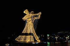 Dancing in the night on the Festival Trip to Christmas. Giant figures of dancers erected for the Festival Trip to Christmas 2017-2018, Moscow, Russia Stock Image
