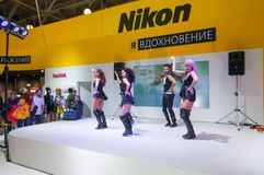 Dancing on Nikon stand Royalty Free Stock Images