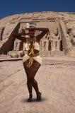 Dancing Nubian Princess, Egypt, Abu Simbel. A dancing Nubian princess in ancient Egypt. The Egyptian goddess is doing a dance by Abu Simbel Royalty Free Stock Photo