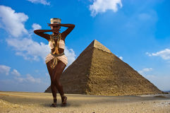 Dancing Nubian Princess, Egypt, Pyramid. A dancing Nubian princess in ancient Egypt. The Egyptian goddess is doing a dance by the Great Pyramid in Giza stock photography