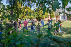 Dancing orphanage children and tourists Royalty Free Stock Photography