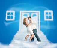 Dancing pair on dream cloud door way collage. Dancing pair on dream cloud door way and windows collage on blue stock photo