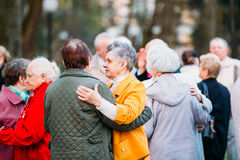 Dancing Pair In Years On Outdoor Dance Floor Among Dancing Solus Stock Image
