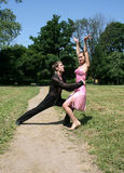 Dancing in a park Stock Photography