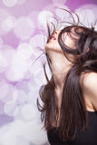 Dancing party woman with hair in motion. Dancing young brunette woman with hair in motion Royalty Free Stock Photography