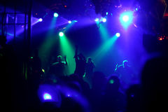 Dancing people. In an underground club stock image