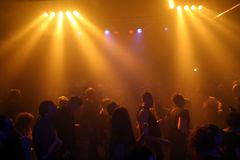 Dancing people. In an underground-club Royalty Free Stock Images