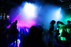Dancing people. In a disco stock images