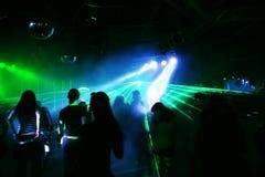 Dancing people. Behind laser/spotlight stock images