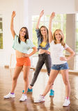 Dancing people. Beautiful young women in dance studio are posing and smiling to the camera Stock Photography