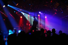 Dancing people/dancer in a steel cage. Dancing people in an underground club stock photo