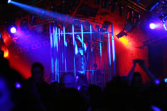 Dancing people/dancer in a steel cage. Dancing people in an underground club Royalty Free Stock Photo