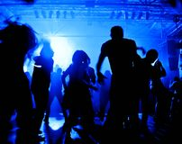 Dancing people in a disco Royalty Free Stock Photos