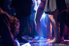 Dancing people in discotheque. With confetti on the dance floor Royalty Free Stock Image