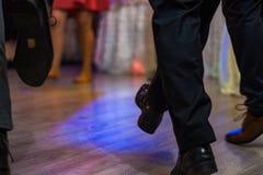 Dancing people feet on stock image