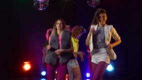 Dancing people with fun gladness on the discotheque entertainment . Smoke background. Dancing people with fun gladness on the discotheque entertainment gaiety stock footage