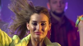 Dancing people with fun gladness on the discotheque . Smoke background. Slow motion